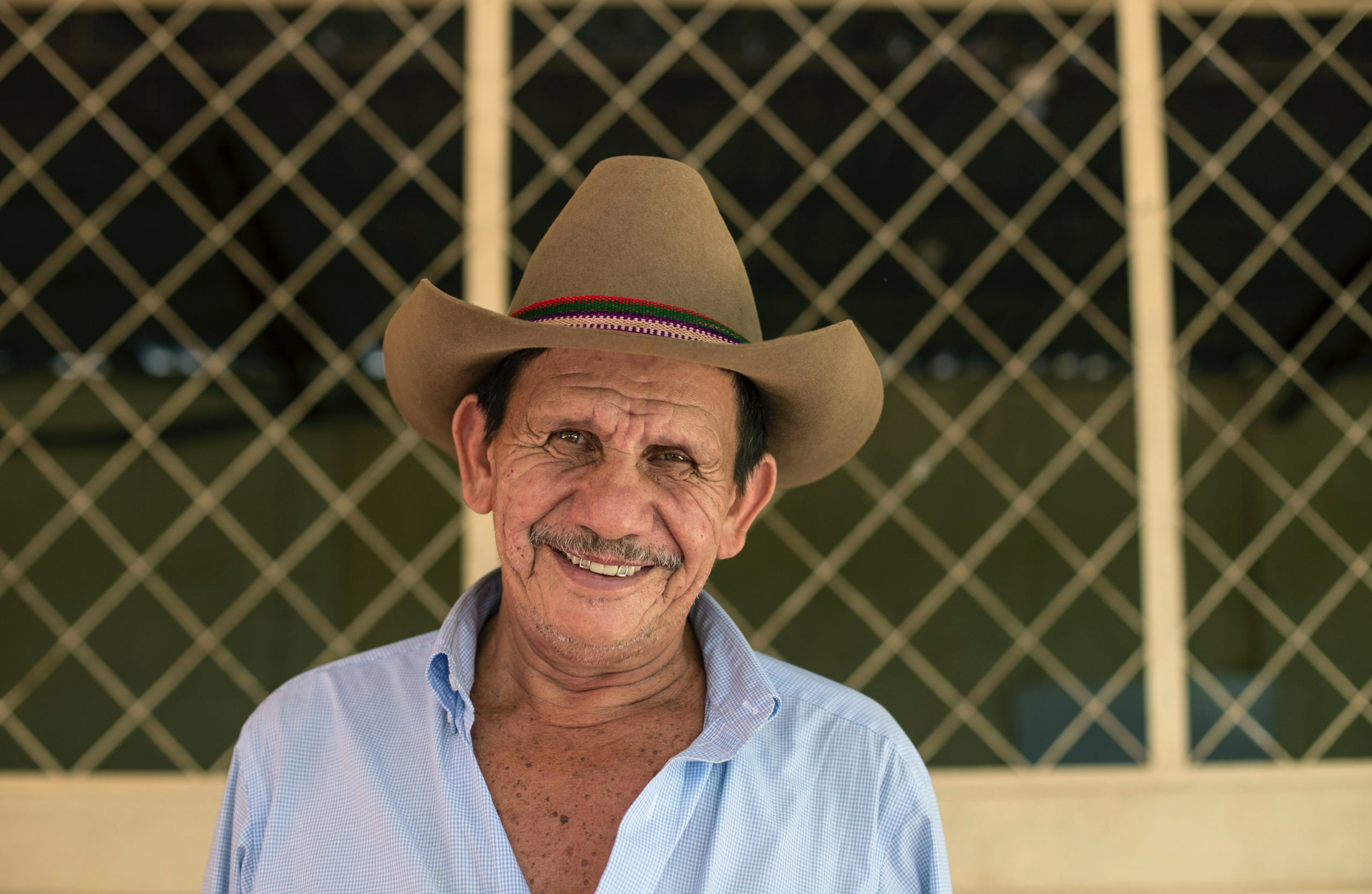 man wearing brown cowboy hat